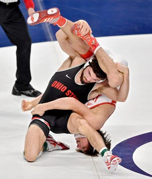Ohio State's Sammy Sasso controls Ridge Lovett of Nebraska on his way to a Big Ten wrestling title at 149 pounds on Sunday in State College, Pa.