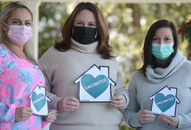 Claudine Wrighter, center, is spreading the idea for people who are fully vaccinated to post teal heart symbols in their windows as a sign of hope and encouragement. She's received help with her #EXITCOVID campaign from Falmouth Hospital emergency room nurses Amy Green, left, and Lauren Seitz.