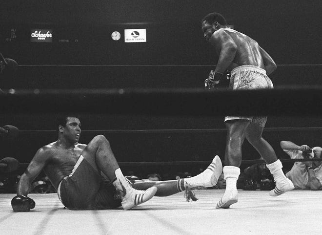 Joe Frazier stands over Muhammad Ali after knocking him down in the 15th round of their championship fight on March 8, 1971 — the first and true Fight of the Century.