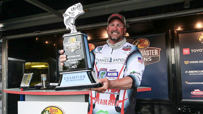 Keith Tuma poses for pictures after winning the 2021  Bassmaster Southern Open on the Harris Chain of Lakes Saturday with a three-day total of 58 pounds, 13 ounces.
