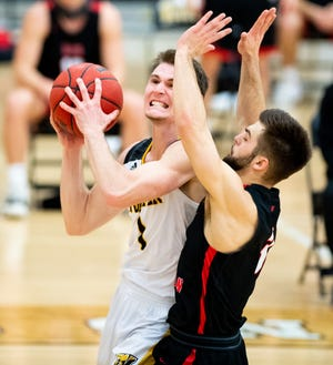 Wooster senior Brandon Styers drives against Ohio Wesleyan during his final college game.