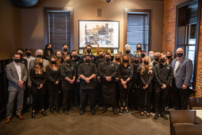 The staff of The City Square Steakhouse, flanked by owner Mike Mariola (far left) and Certified Angus Beef Brand President John Stika (far right). Certified Angus Beef awarded $2,500 to the restaurant staff as part of its #RestaurantChallenge.