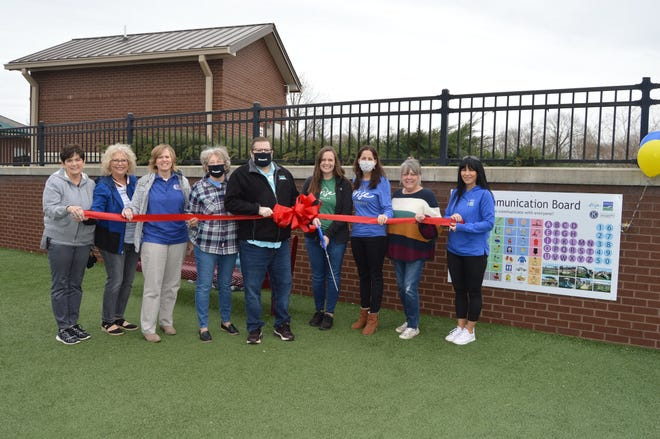 Members of Arise Therapies, Spring Hill Parks and Recreation and Kiwanis of Spring Hill & Thompson's Station celebrate a ribbon cutting of new interactive Play Communication Boards at Fischer Park at Port Royal on Friday, March 5, 2021.