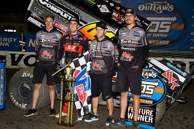 Carson Macedo, second from left, and his crew celebrate winning the World of Outlaws race late Friday night at Volusia Speedway Park in Barberville. March 5, 2021.