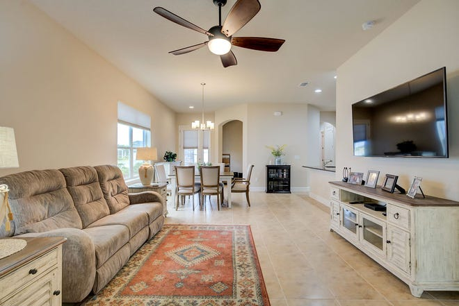 At the heart of this beautiful townhome, the kitchen, dining area and living room are all open to one another, giving it a very spacious feel.