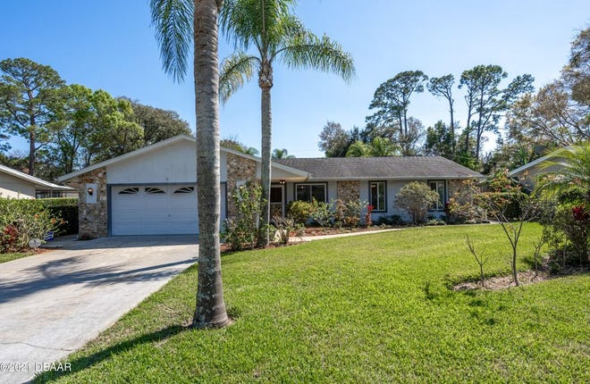 This Ormond Beach pool home sits on over a half an acre on a quiet street within walking distance to Central Park and Riviera Golf Course.