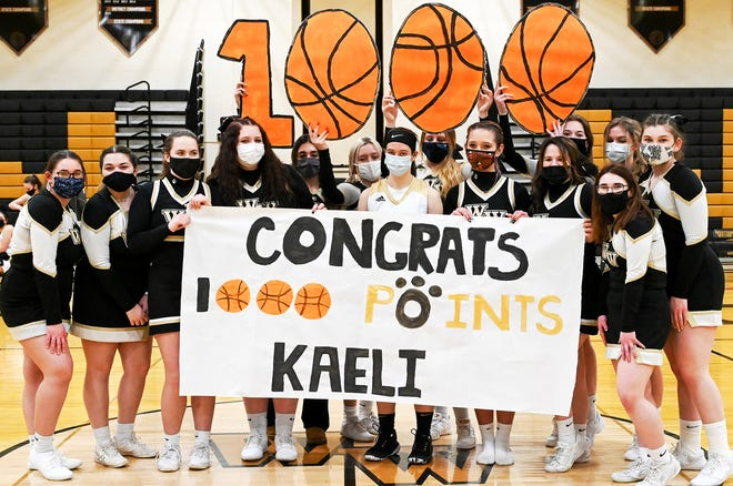 Western Wayne's Kaeli Romanowski has earned her membership card in the exclusive 1,000-Point Club. The junior guard reached this hoops milestone by scoring a game-high 28 points in a Lackawanna League win over Delaware Valley. Kaeli is picture here with members of the cheerleading squad after the game.