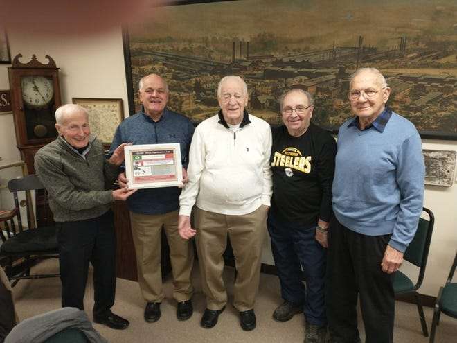 John Biondi, an Ellwood City Italian American Heritage Foundation member, presents an appreciation plaque to Wolves Club President  Mike DeOtto and 50-year Wolves Club members in Ellwood City.  Pictured, left to right, are Biondi, DeOtto, Carl Agostinelli, John Maielli Sr. and Dr. Anthony DiBiagio.