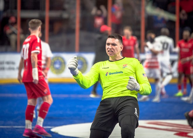 Kansas City Comets goalkeeper Nicolau Neto pumps his fist to celebrate a 7-6 come-from-behind victory over the Ontario Fury in the MASL playoffs last season. Neto has signed a two-year contract to remain with the Comets.