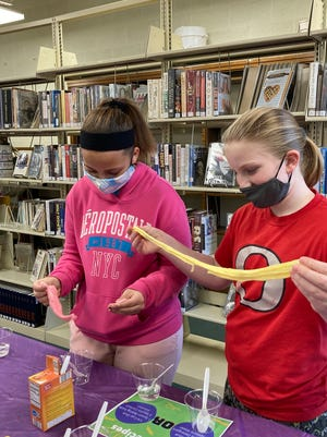 Western District Library, Orion, is starting a Tween Club for students from fifth through eighth grades. On Friday, March 5, the first session featured slime. After mixing up a cup of slime, Aubree James, left, and Irelyn Thorndyke, right, stretch it out.