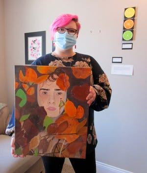 """Olivia Koning, a senior at Geneseo High School, shows a piece of her artwork, """"Buoyant,"""" included in the exhibit of art on display at Smith Studio and Gallery in downtown Geneseo."""