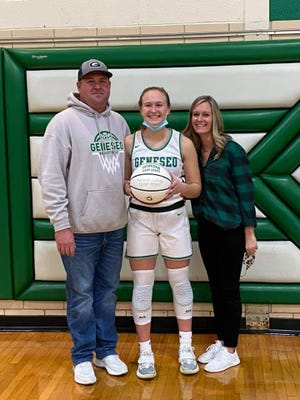 Kammie Ludwig with parents, Justin and Jennifer, at the Geneseo-UT game on Friday, March 5 in Geneseo.