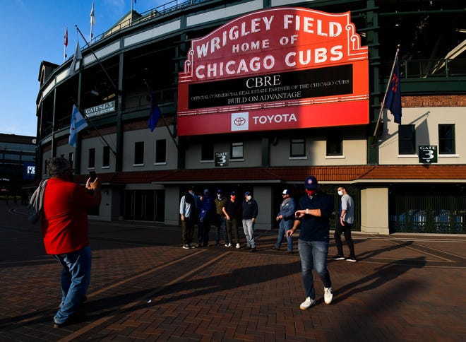 Chicago Cubs fans stand outside of Wrigley Field before a Sunday, Sept. 20, 2020 game against the Minnesota Twins in Chicago.