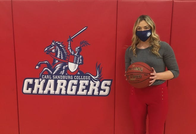 McKenna Weaver, a 2016 Sandburg alumna and former All-Arrowhead Conference and All-Region IV standout with the Chargers, was given the game ball Saturday following her first victory as Sandburg's women's basketball coach.