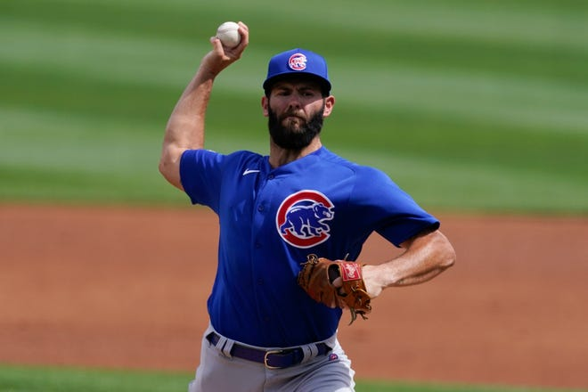 Chicago Cubs starting pitcher Jake Arrieta (49) throws during the first inning of Sunday's spring training game against the Arizona Diamondbacks, in Scottsdale, Ariz.