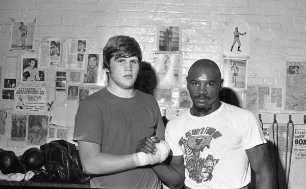Chris McDonald, left, and Marvelous Marvin Hagler, shown in this Herald News file photo from 1976 or '77, are among the distinguished alumni of the Southern New England Golden Gloves amateur boxing tournament which runs its 57th edition the next three Saturdays at the Fall River PAL, 31 Franklin St. McDonald, a heavyweight from Tiverton, was a 1980 United States Olympic Trials finalist, while Hagler, from Brockton, was the undisputed middleweight champion of the world.