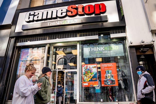 FILE - In this Jan. 28, 2021, file photo, pedestrians pass a GameStop store on 14th Street at Union Square, in the Manhattan borough of New York.