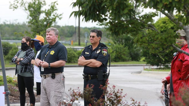Onslow County Sheriff Hans Miller and Jacksonville Police Chief Mike Yaniero attend a peaceful and silent black lives matter protest during the summer of 2020.