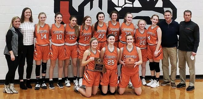 The Kirksville girls basketball team poses with its district title trophy.