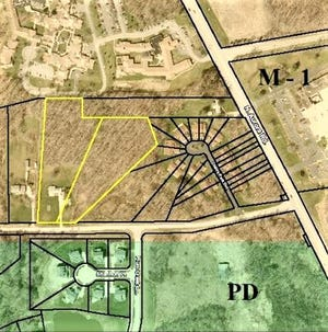 The yellow outlined areas show the location of the proposed Trentstone Glens housing development north of Aurora Lake Road. The Anna Maria complex is at top, Hawthorn of Aurora is at bottom and the Cherry Park Oval condominiums are at right. Treat Road is at upper right. AURORA PLANNING-ZONING DEPT.