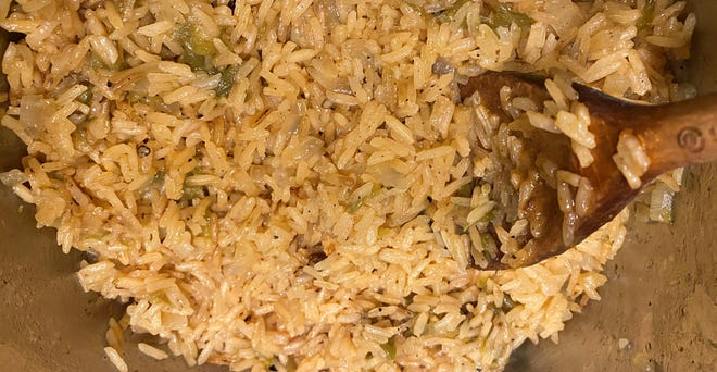 While it's cooking, you can add chicken broth, tomato paste, chiles, garlic salt, cumin, and black pepper to make this flavorful Mexican-style rice.