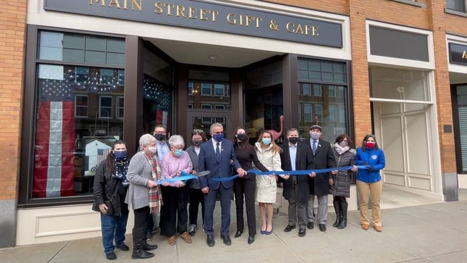 The ceremonial ribbon is cut Friday morning to mark the grand opening of Main Street Gift & Cafe.