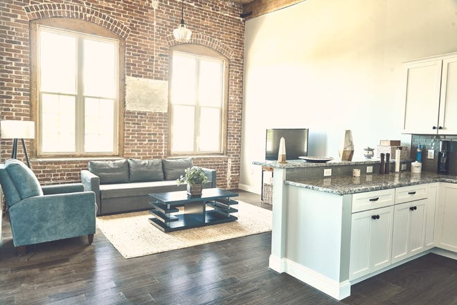 Toy Factory Apartments at 45 Summer St. in Leominster features light-filled living spaces, exposed brick, stainless steel appliances, and soaring cathedral ceilings.