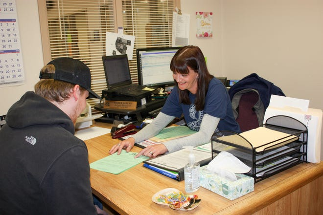 Financial aide director Amber Asbury works with a student to find scholarships. The application deadline for most scholarships is April 1.