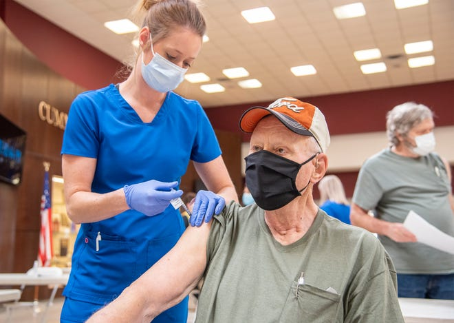 Kerry Carder receives his COVID-19 vaccine at the Camden County mass vaccination event.