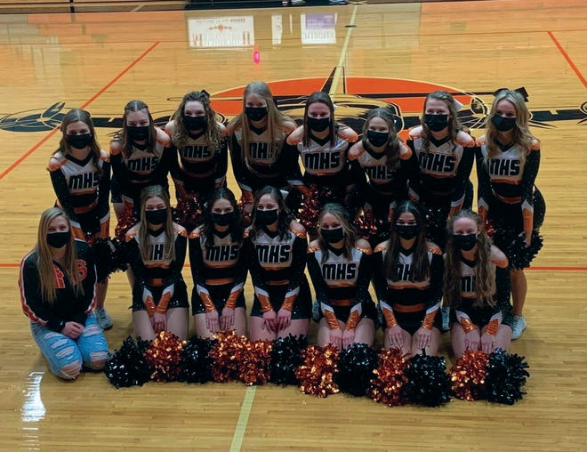 The Macomb High cheerleading squad.