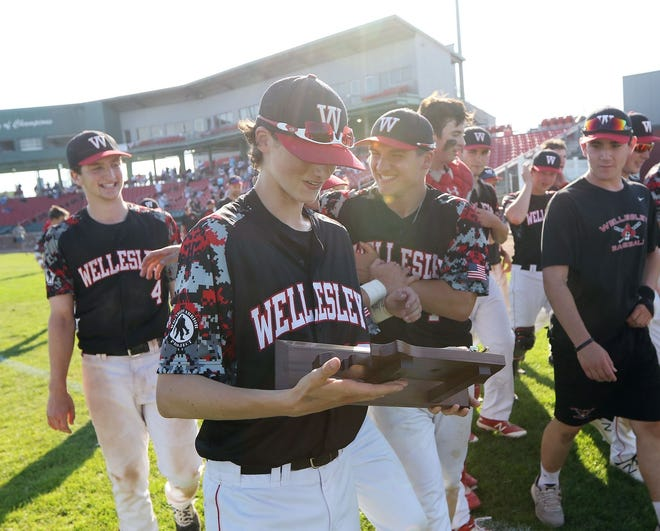 Former Wellesley High baseball player John Woernle holds the Division 1 South sectional championship trophy afer Wellesley beat Bridgewater-Raynham in the sectional title game.