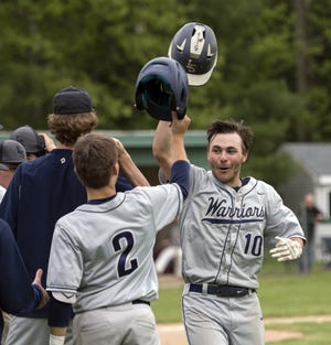 Former Lincoln-Sudbury outfielder Connor Lachman celebrates  Connor Peek (front) during the first round of the Rich Pedroli Memorial Daily News Classic against Natick High at Mahan Field in Natick, May 23, 2019. Baseball will return to high school athletics this year after the spring sports season was canceled last year.