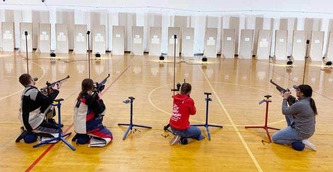 Moberly High School JROTC student cadets take part in an air rifle shooting competition.