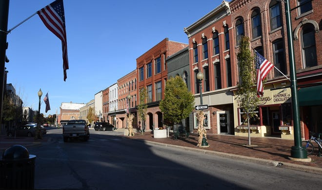 Several businesses in Downtown Monroe are pictured. Monroe City Council on Saturday discussed the possibility of allowing retail recreational marijuana facilities in the downtown.