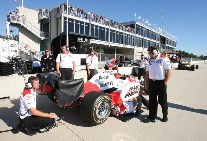 In this Oct. 12, 2007, file photo, Team Penke crew members make adjustments to the car of Helio Castroneves, of Brazil, during IndyCar Series testing Barber Motorsports Park near Birmingham, Ala. Hardin Valley Land Partners are proposing building a motorsports park complex in the Horizon Center on the west end of Oak Ridge, Tenn. (AP Photo/Michael E. Palmer, File)