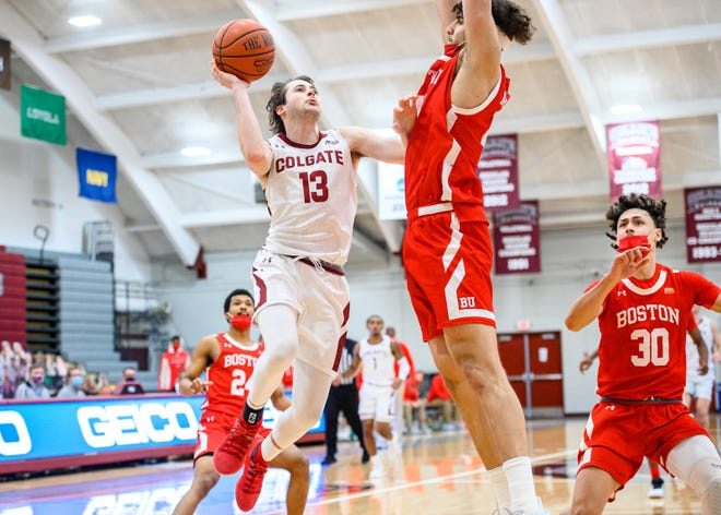 Colgate guard Jack Ferguson (13) goes up for a basket March 6 as the Raiders men's basketball team bested Boston University 77-69 in a Patriot League quarterfinals game in Hamilton.