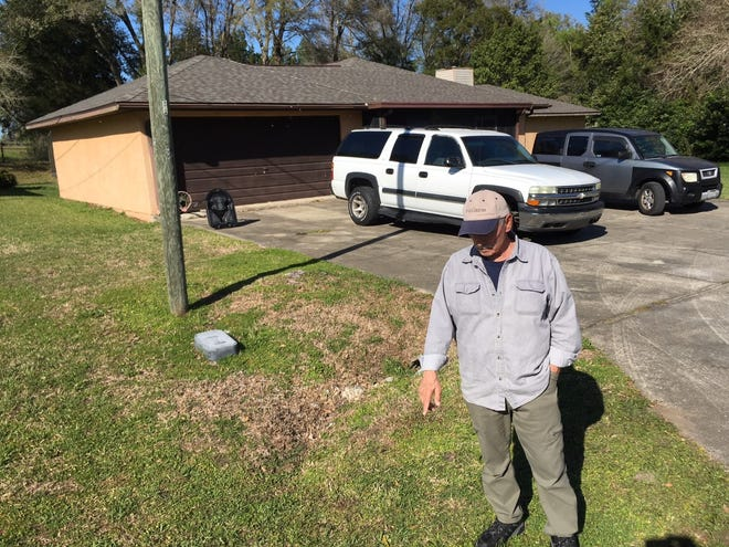 Next door neighbor Nick Fanelli points to the spot where Joann Chiswick was shot Sunday night.