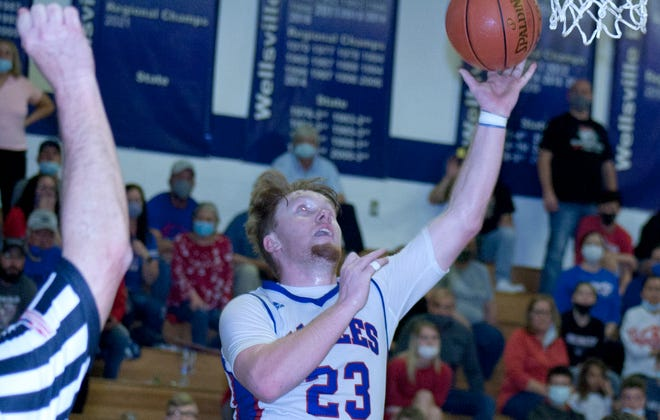 Wellsville senior Jackson Showalter was fouled as he took the ball to the basket with the game tied at 65 in the final minute.