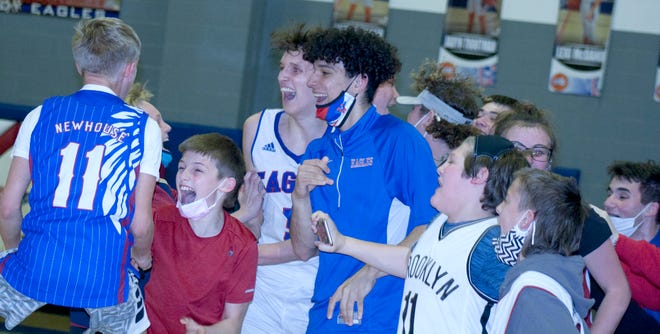 Wellsville senior Jimmy Dorsey (5) celebrates a sub-state championship with Eagle fans and the student body.