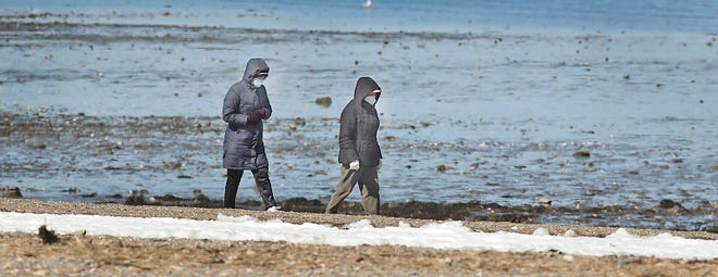 Out for some fresh air and sunshine on Wollaston Beach, Quincy with a mask on Monday March 8, 2021 Greg Derr/The Patriot Ledger