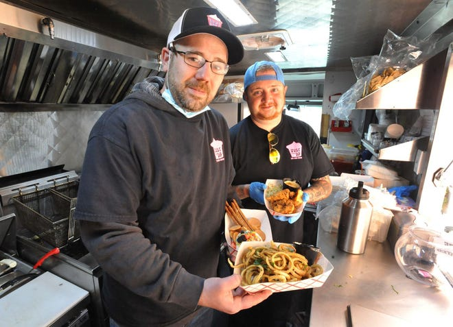 Just the Dip food truck owners Dan Wilder of Plympton, left, and Joe DiFrancesco of Rockland prepare to serve food at the Plymouth Industrial Park, Saturday, March 6, 2021.