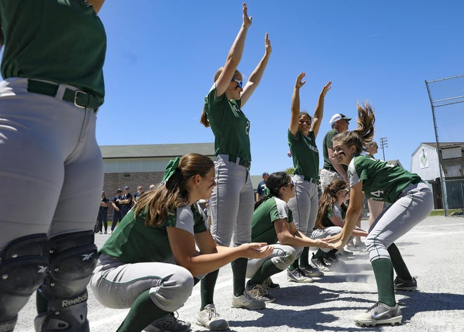 Abington's Meghan McCann high-fives down the line of her teammates as she is introduced before the start of a Division 3 South Sectional quarterfinal against Coyle-Cassidy on Sunday, June 9, 2019.