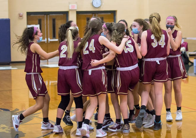 Members of the Portsmouth High School girls basketball team celebrate after Sunday's Division I quarterfinal win at Exeter.