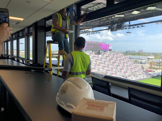 Workers put the finishing touches on the suites in Inter Miami's stadium during a media tour on March 12, 2020. The team's long-awaited home debut, scheduled for two days later, was called off when Major League Soccer suspended its season.