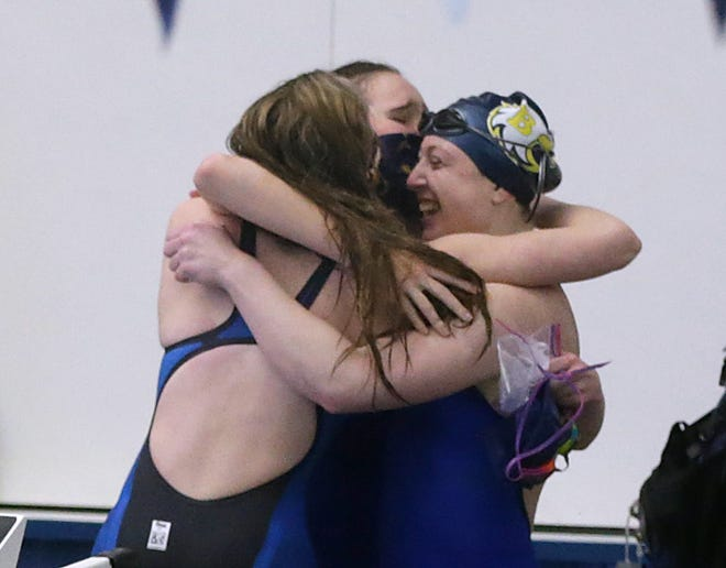 Barrington 400m freestyle relay swimmers celebrate after winning the event that helped them clinch the Division I championship on Sunday.