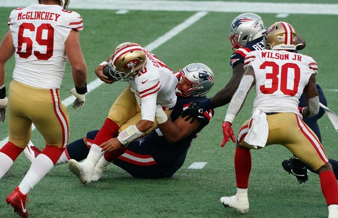 Patriots defensive tackle Lawrence Guy sacks 49ers quarterback Jimmy Garoppolo during a game on Oct. 25.