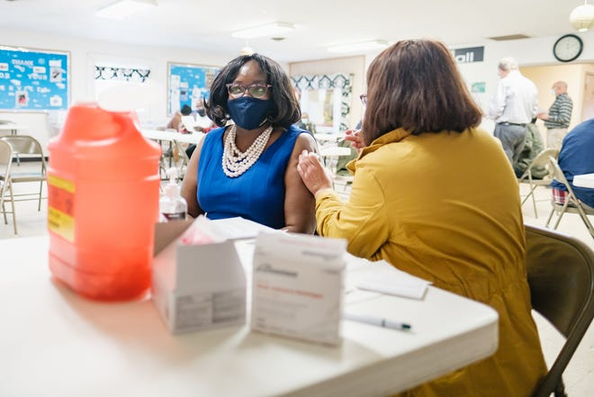 Portage County NAACP President Dr. Geraldine Hayes-Nelson receives her Covid-19 vaccination Monday at Skeels-Mathews Community Center in Ravenna. On Monday, the CDC announced new guidelines for people fully vaccinated against the COVID-19. Andrew Dolph for the Record-Courier
