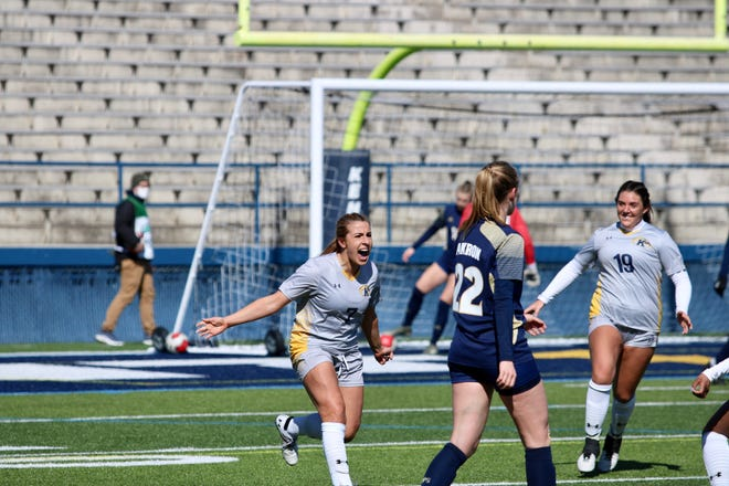Yasmine Hall (left) celebrates after scoring the lone goal in Kent State's 1-0 victory over Akron on Sunday at Dix Stadium. Flashes teammate Amanda Winquist (right), who assisted on the goal, looks on.