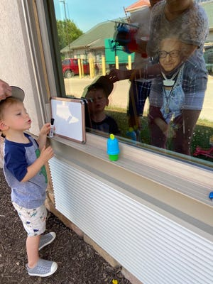 Henry Studeny, 2, son of Adam and Sara Studeny, visits with grandma Ida Pedrotty at The Gables of Canton.