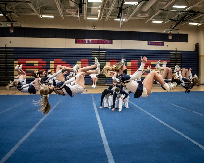 The Belvidere North cheerleading squad backflips together during the routine that won sectionals over the weekend. The Blue Thunder will now submit their performance for the virtual state meet, which will be judged this weekend.
